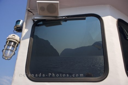 Photo: Reflections Western Brook Pond Newfoundland