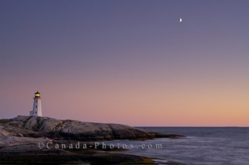 Photo: Sunset Moon Peggys Cove Lighthouse Nova Scotia Canada