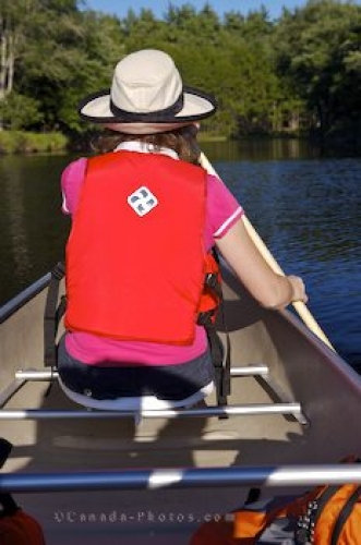 Photo: Woman Canoeing Mersey River Kejimkujuk National Park Nova Scotia