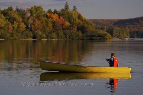 Photo: Woman Canoeing Rock Lake Ontario Canada