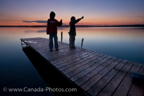 Photo: Young Boys Wharf Fishing At Sunset Lake Audy Manitoba