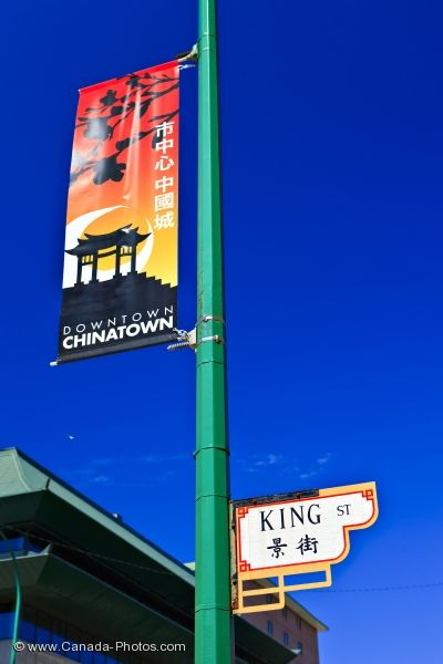 Photo: Chinatown Street Sign With Banner Winnipeg City Manitoba