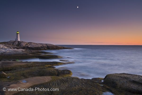 Photo: Peggys Cove Lighthouse With Sunset Moon Nova Scotia