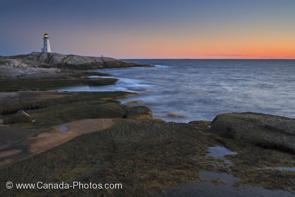 Photo: Picturesque Sunset Peggys Cove Lighthouse Nova Scotia